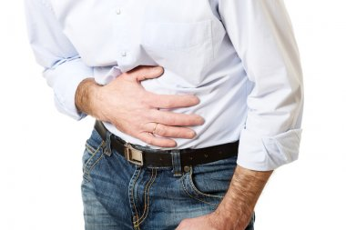 Close up on mature man suffering from stomachache