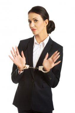 Full length businesswoman with handcuffs