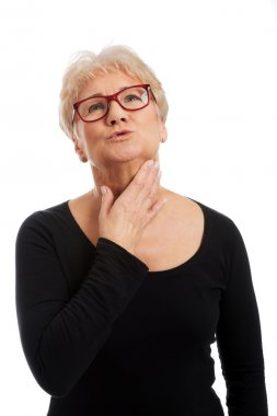 Old woman with throat pain