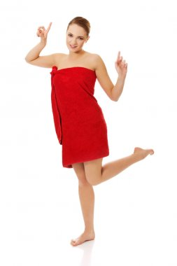 Happy woman wrapped in towel.