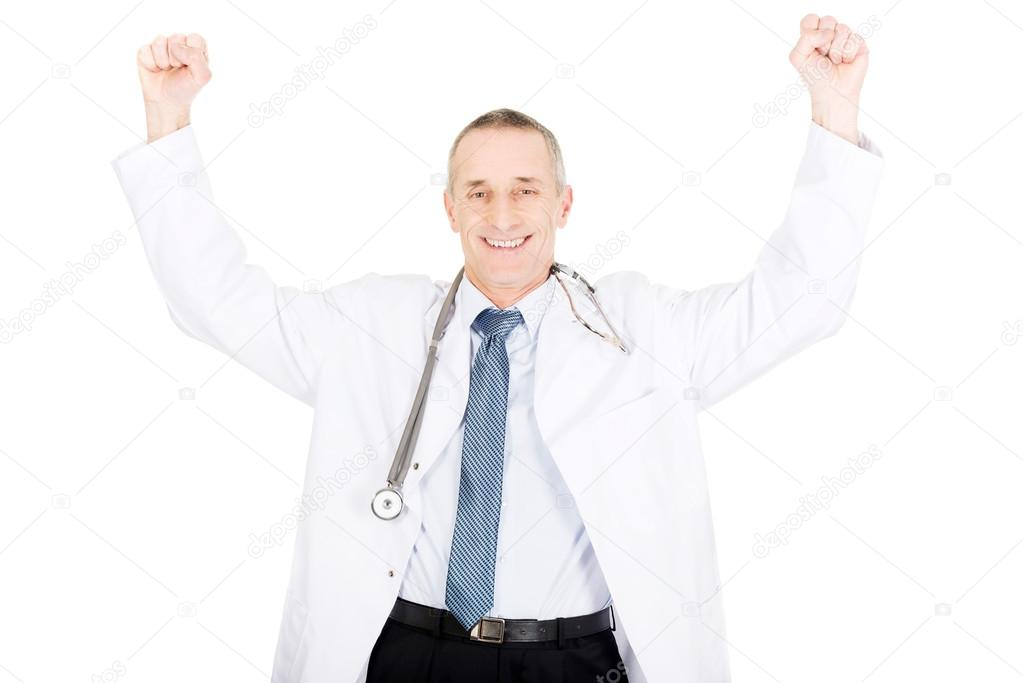 7acdaba0f23ebd depositphotos 65200039-stock-photo-happy-male-doctor-with-raised.jpg