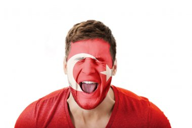 Screaming man with Turkish flag on face.