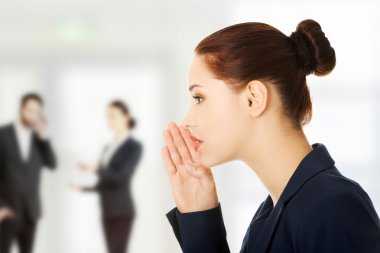 Businesswoman talking gossip