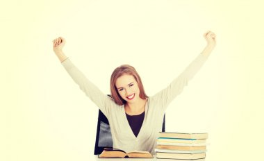 Happy woman finished preparing to exam