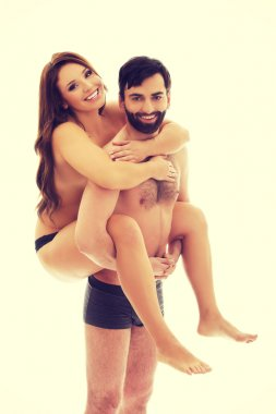 Man carrying girlfriend on his back.