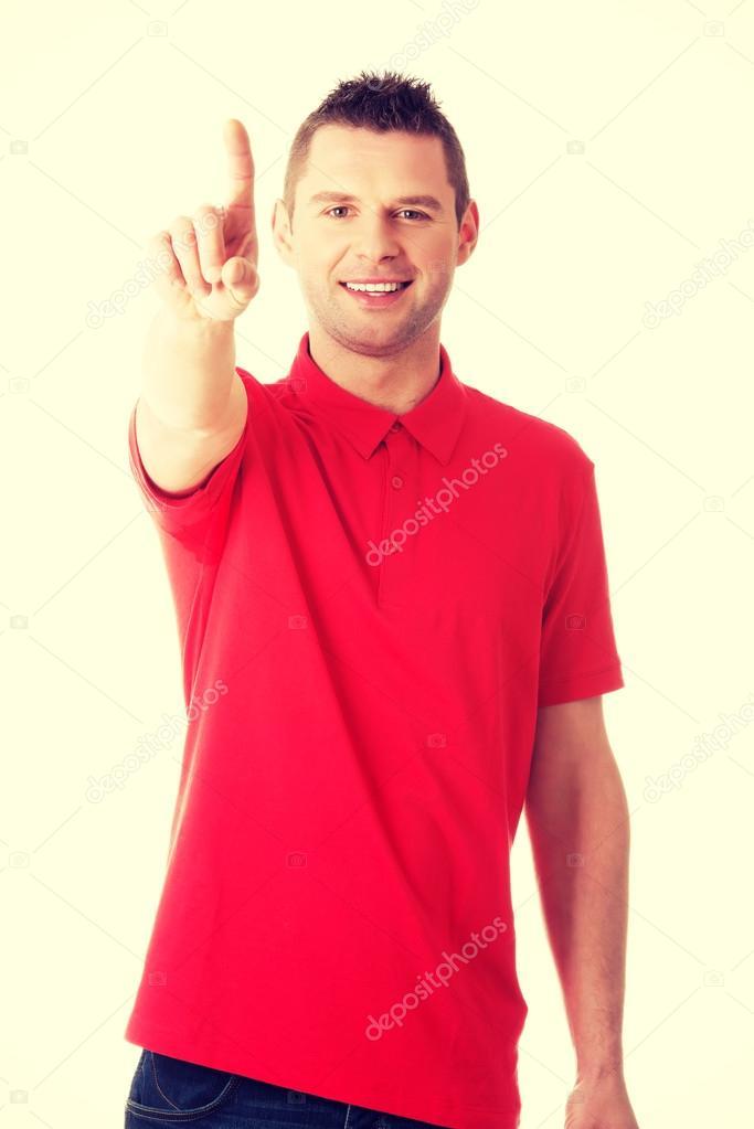 Man pressing an abstract touchscreen button