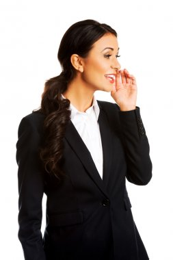 Businesswoman whispering to someone