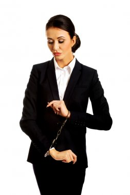 Businesswoman with handcuffs