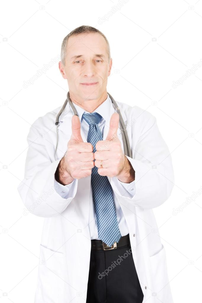 Confident mature male doctor with thumbs up.