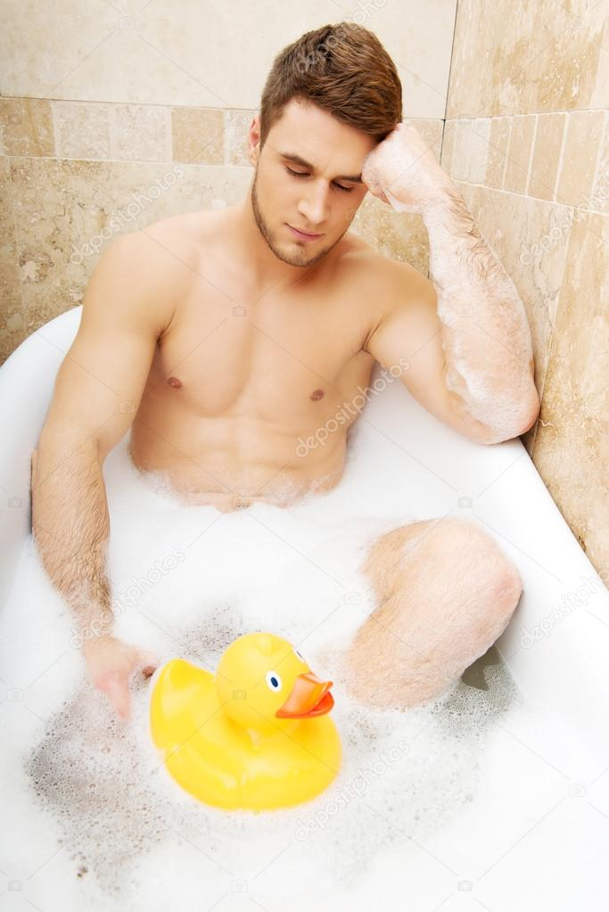 Naked men with a rubber ducky photo 992