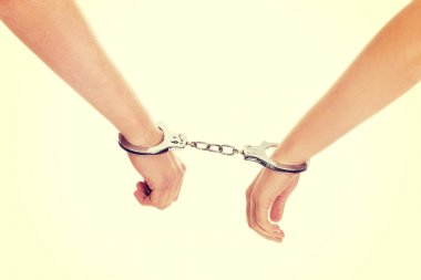 Male and female handcuffed.
