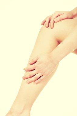 Woman massaging her leg.