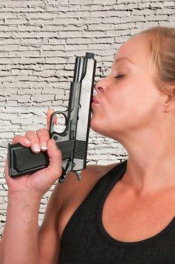 Woman Kissing Gun