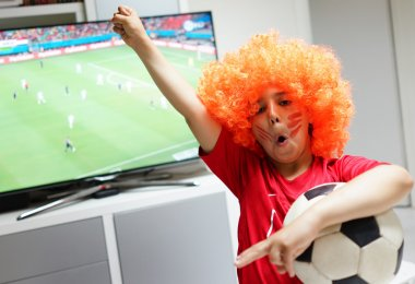 Kid  watching football world cup game on tv