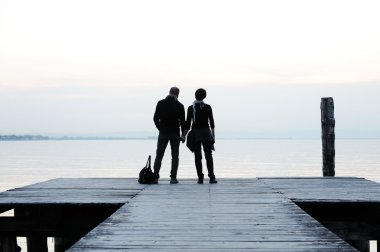 Couple on the wooden dock