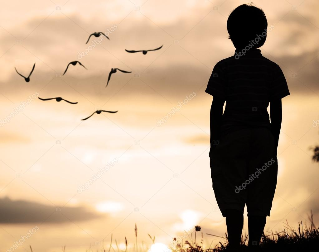 Lonely boy at sunset stock photo