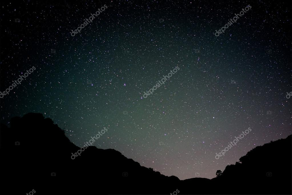 The Milky Way and some trees in mountains