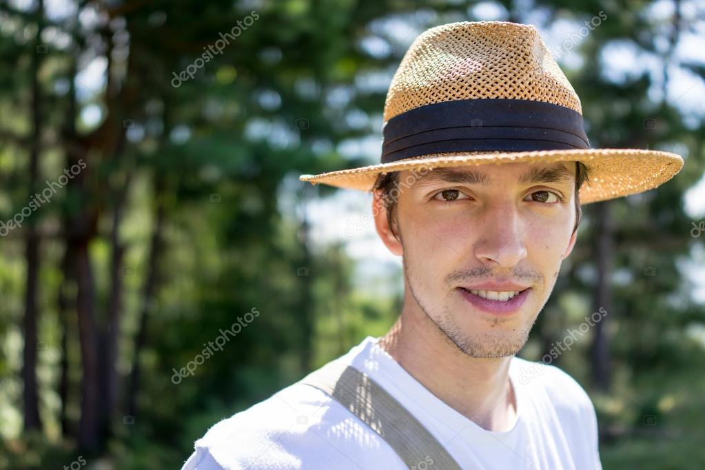 Young man enjoying in natural park