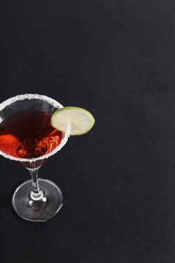 Red Cosmopolitan with lime