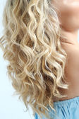 Fotografie Blond woman with curly hair