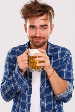 Man in blue shirt with beer
