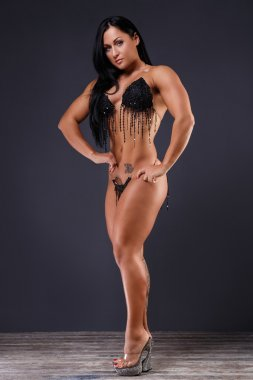 Gorgeous female bodybuilder with perfect body