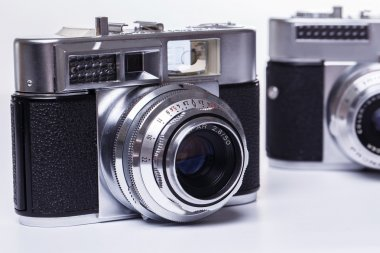Retro cameras on a white