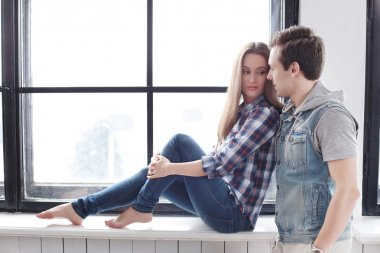Beautiful couple by the window