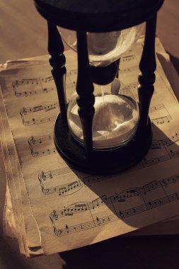 Music notes with hourglass