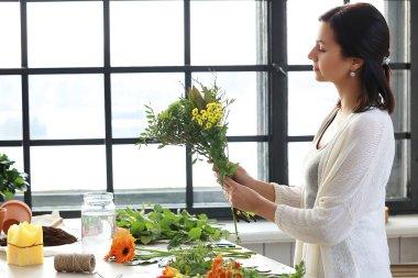 Woman gardener with flowers