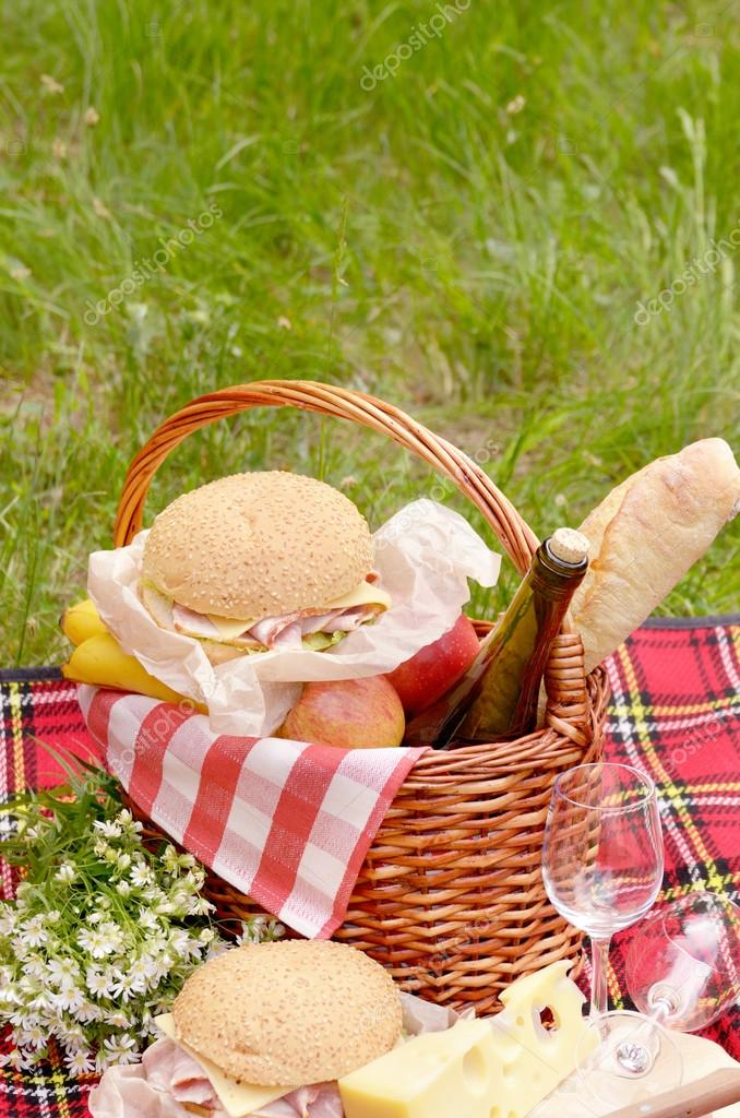Picnic basket with apples and cheese