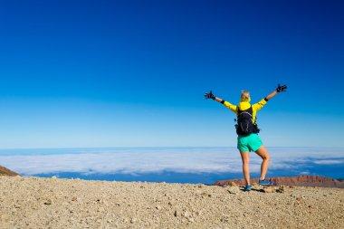 Woman hiking success climber on mountain top