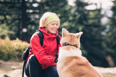 Happy woman hiking walking with dog