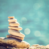 Fotografie Stones balance, vintage pebbles stack background