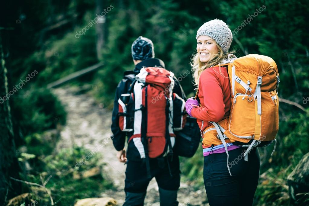 Couple hikers walking in mountains