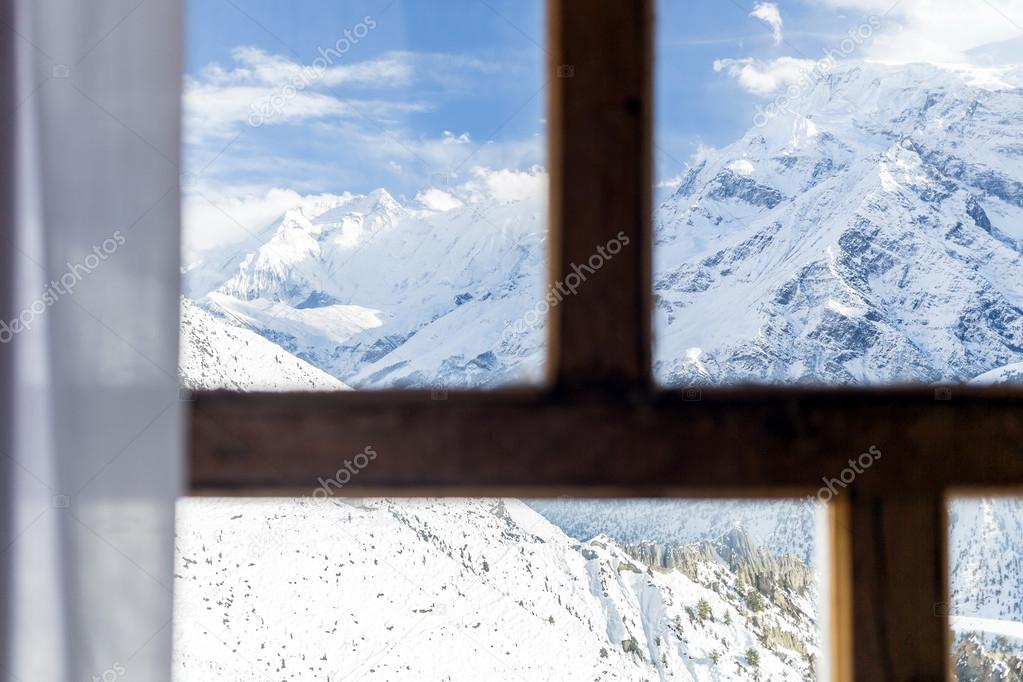 Looking through window at Himalaya Mountains
