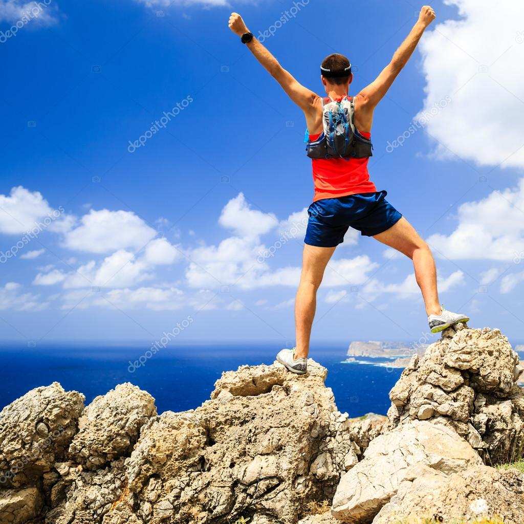 Happy man reaching life goal success inspiration