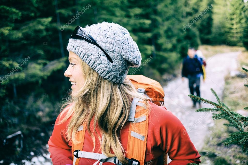 Couple hikers camping and hiking in forest