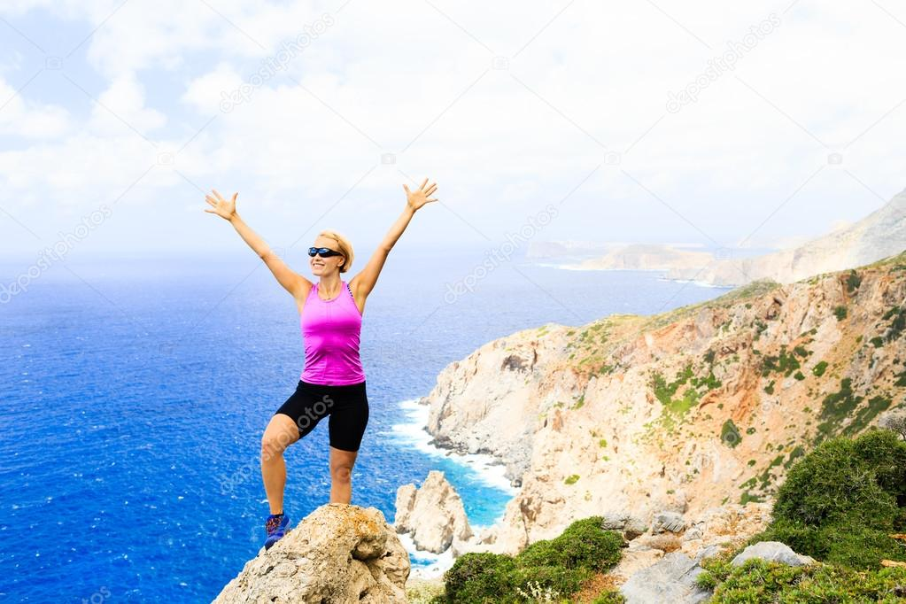Happy climber woman winner reaching life goal success