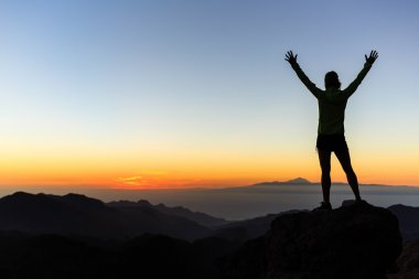 Woman climber success silhouette in mountains, achievement inspi