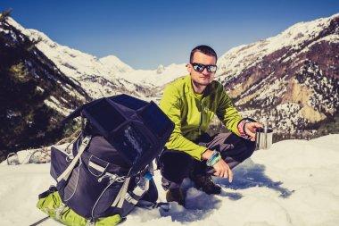 Man camping and hiking in Himalaya Mountain pass in Nepal