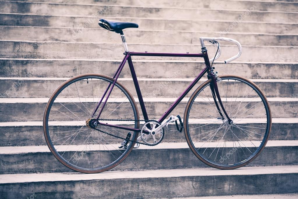 Road retro bicycle and concrete stairs, urban scene vintage