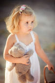 Portrait of baby girl with toy bear