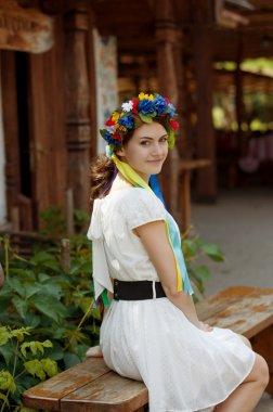 Ukrainian beautiful girl in national chaplet stock vector