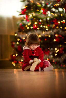 Little girl in Santa Claus clothes