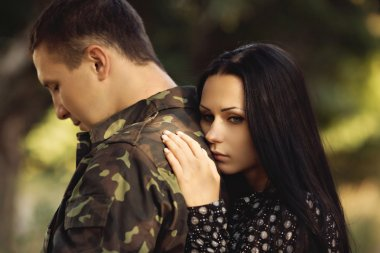 Sad woman and soldier