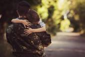 Boy and soldier in a military uniform