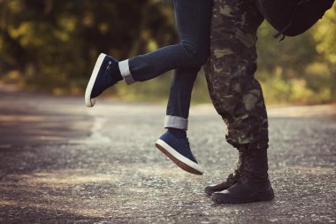 Woman and soldier legs