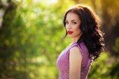 Fotografie woman in violet dress outdoors