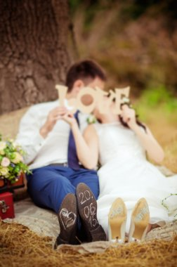 Bride and groom with word love
